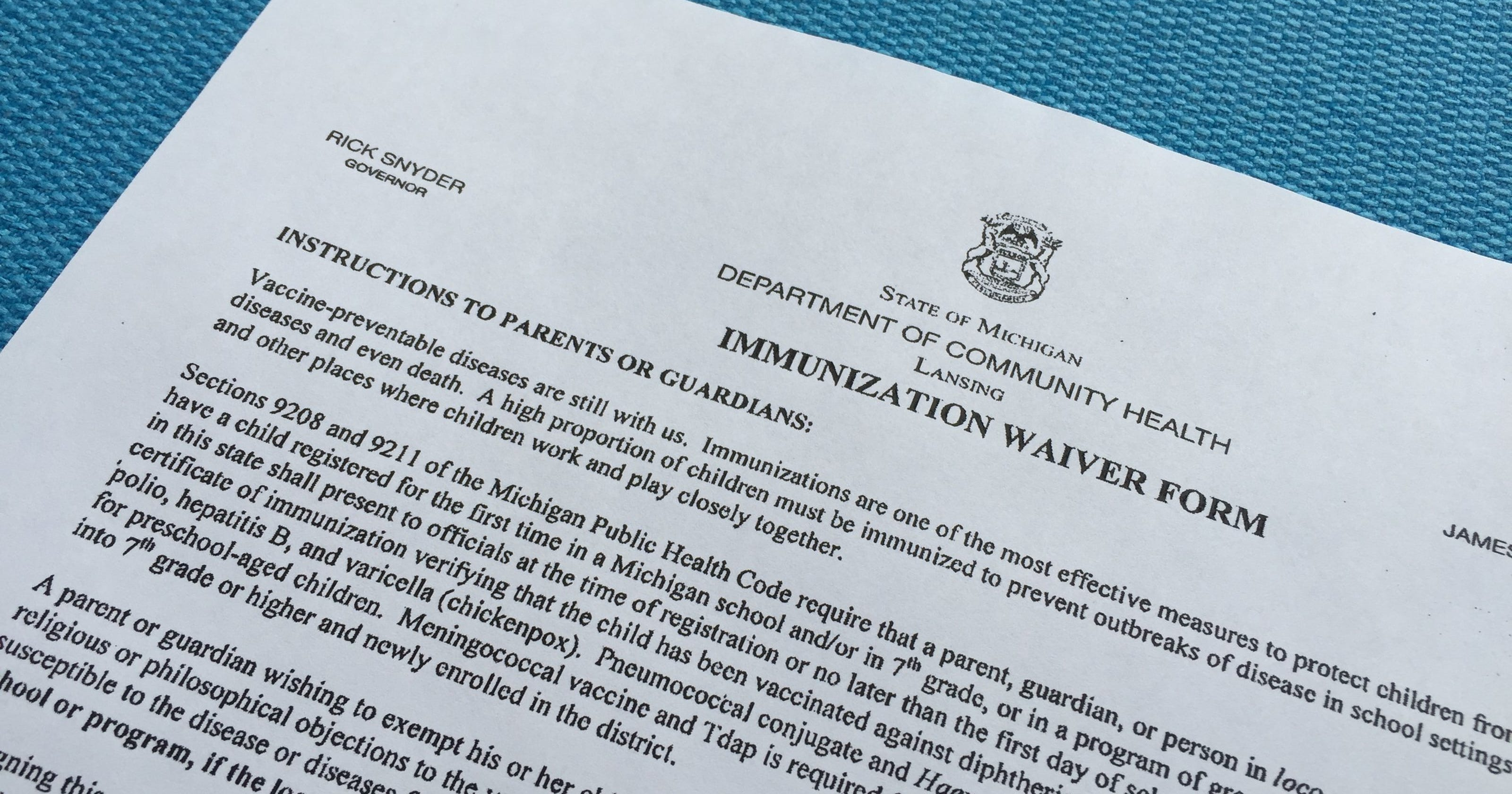 Michigan to require more work to get vaccine waiver