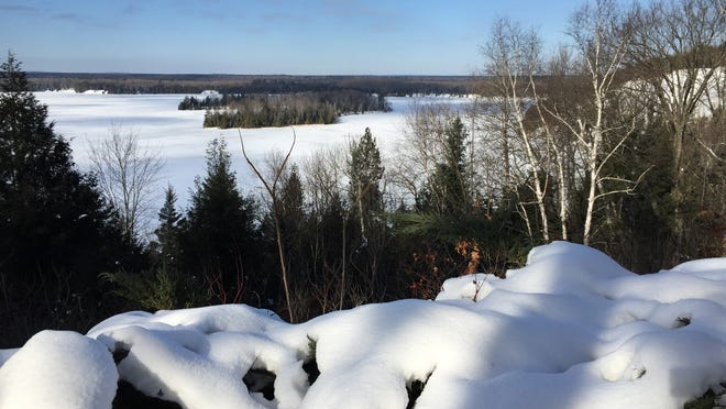 Lumberman's Monument west of Oscoda, Michigan, shimmers in late January.