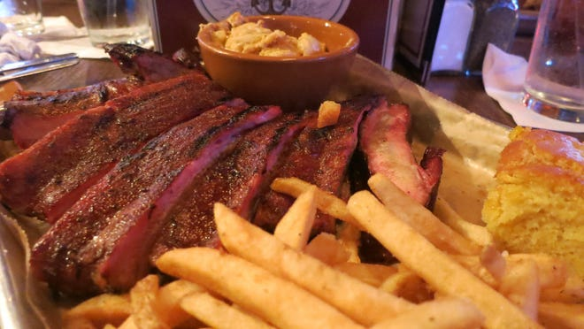 Ferndale's new Zeke's Rock & Roll BBQ features an extensive menu of smoked meats, along with starters, salads, sandwiches and sides. Plates come with a meat, cornbread and choice of two sides.