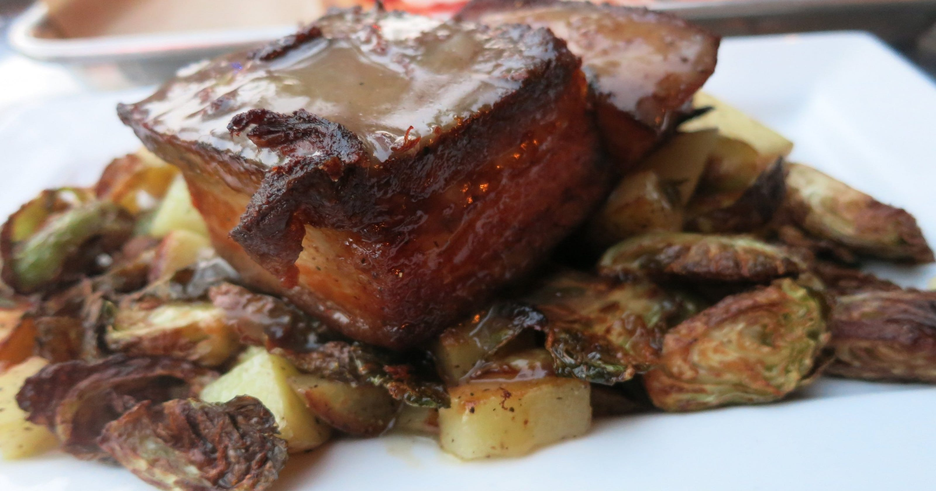 What is pork belly and how is it prepared?