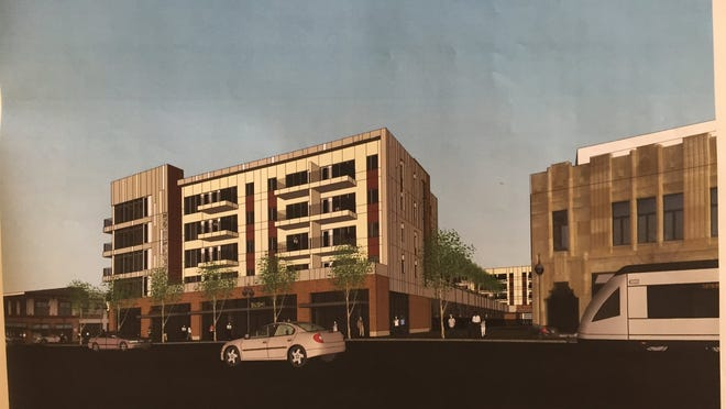 Rendering submitted to Detroit City Council in March 2015 for a planned new mixed-use apartment complex in Midtown Detroit to be called The Scott @ Brush Park. The rendering shows the view from Woodward and M1 Rail northeast.