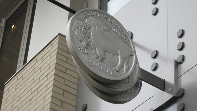 A trio of oversized Buffalo nickels is used for the sign at the Triple Nickel restaurant and bar, set to open Monday in the 555 apartment building on South Old Woodward in Birmingham.