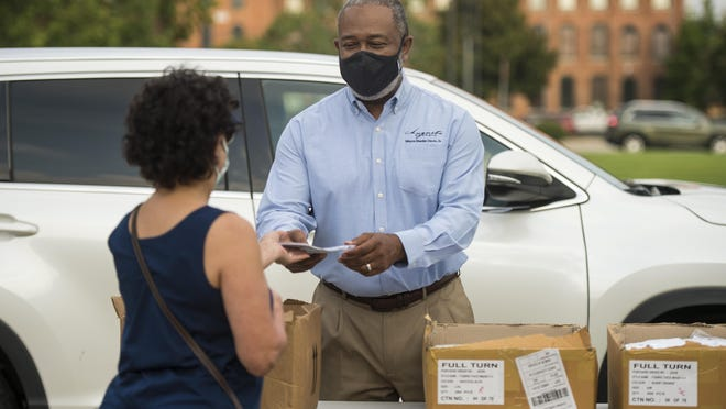 Augusta Mayor Hardie Davis hands out free masks during the mask and hand sanitizer giveaway at the Salvation Army Thursday morning August 12, 2020 in Augusta, Ga.