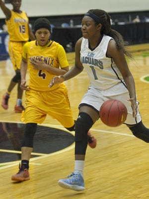 East Gadsden High School's Dondrea Harris (1) drives toward the basket as East Gadsden High School's Cyann Fox (4) tries to defend during the second half of their FHSAA Girls 4-A Semifinal game at The Lakeland Center Wednesday. Brooks-DeBartolo won the game 66-55. February 17, 2016