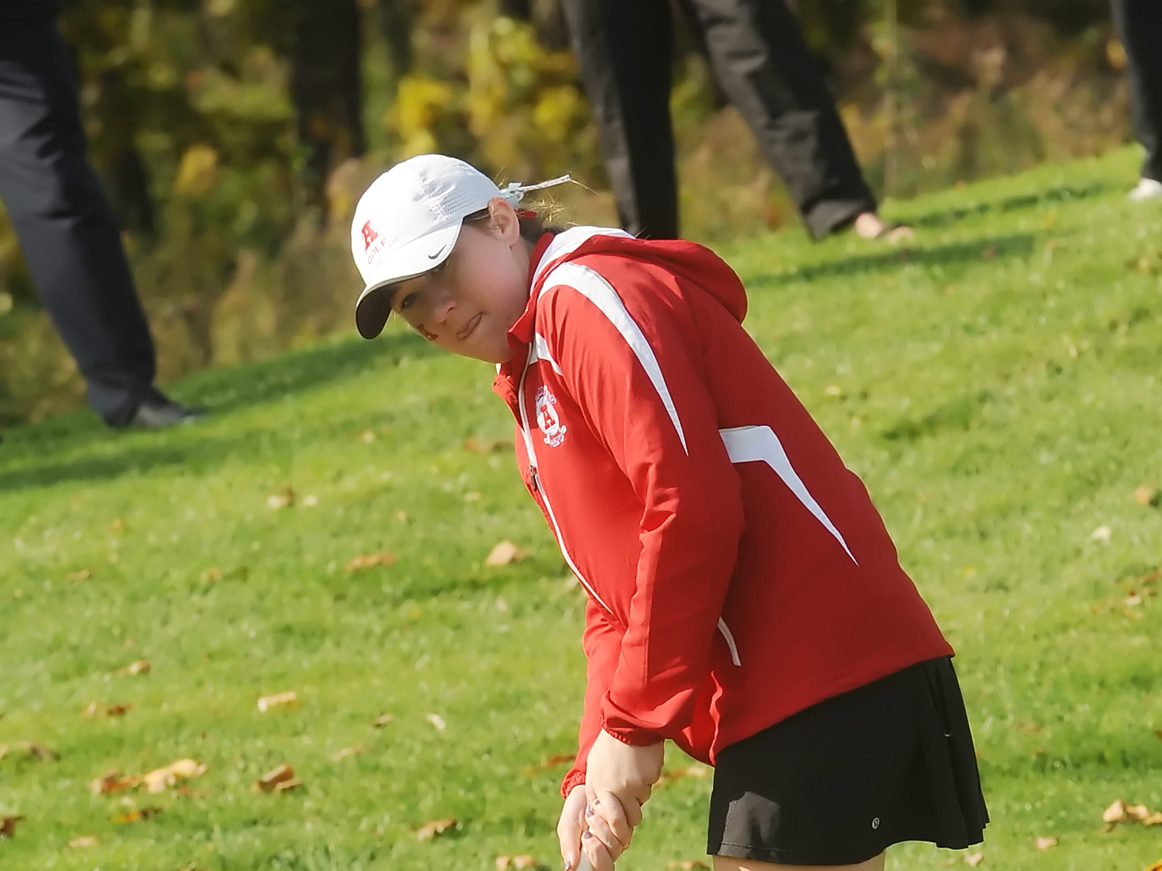 Arrowhead sophomore Emily Lauterbach watches her putt