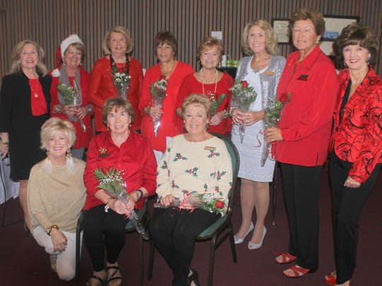 Membership chairpersons present roses to birthday ladies. Back: Janet Dickens, Pat Hagedorn, Rachel DeHanas,  Pam Cote, Pat Dugas, Betsy Wohltman, Sharon Weathers and Candy Seward; front: Sharon Cook, Ginger Finlayson and Jan Minuitti.