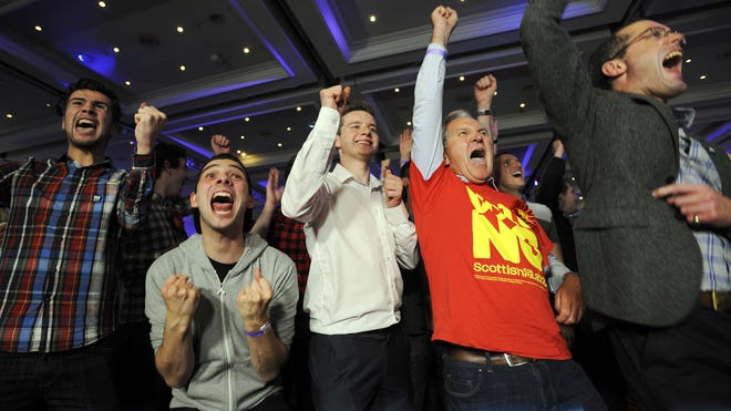 Pro-union supporters react as Scottish independence referendum results come in at a Better Together event in Glasgow on Sept. 20, 2014.