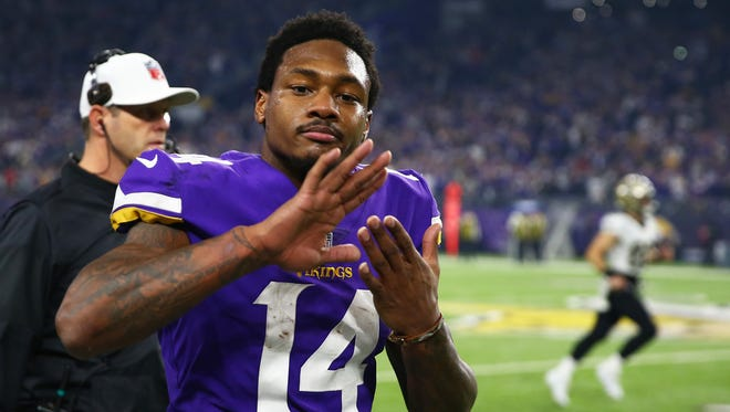 Minnesota Vikings wide receiver Stefon Diggs celebrates after catching the game winning catch against the New Orleans Saints at U.S. Bank Stadium.