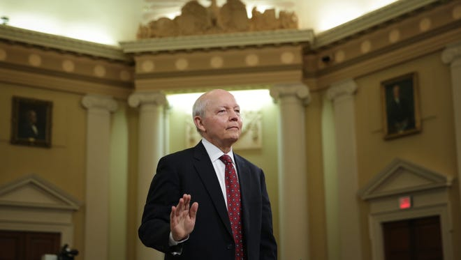 Internal Revenue Service (IRS) Commissioner John Koskinen is sworn in during a hearing before the House Ways and Means Committee June 20, 2014 on Capitol Hill in Washington, DC. The hearing was to focused on the missing e-mails from the hard drive of former director of the IRSs Exempt Organizations Division Lois Lerner.