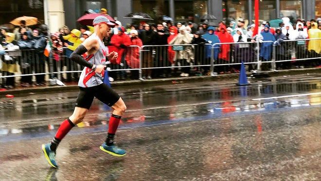 Michael Andersen of Brighton approaches the finish line of the Boston Marathon on Monday, April 16, 2018.