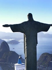 Christ the Redeemer statue surveys Rio de Janeiro, Brazil from  Corcovado mountain.