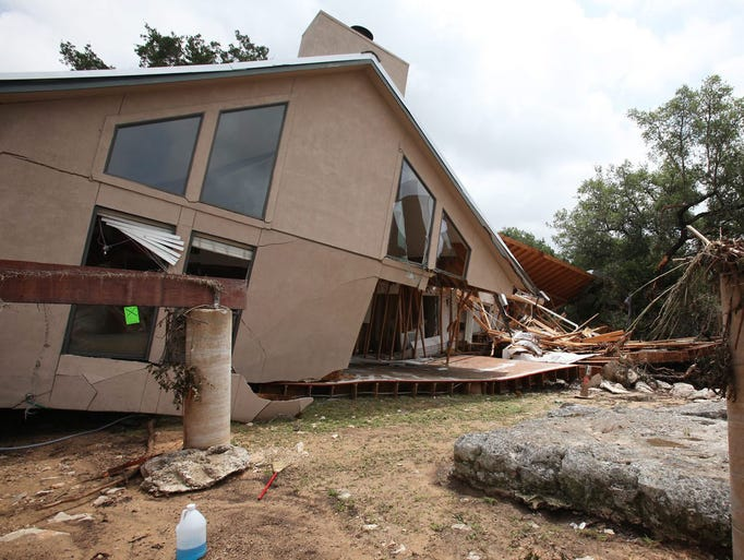 epa04769391 A flood damaged home sits beside its foundation