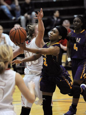 Male's Ciaja Harbinson (2) shoots against Incarnate Word on Saturday during the Raatz Fence/O'shea's Classic at Mercy Academy. (Photo by David Lee Hartlage, Special to The Courier-Journal) Jan. 21, 2017