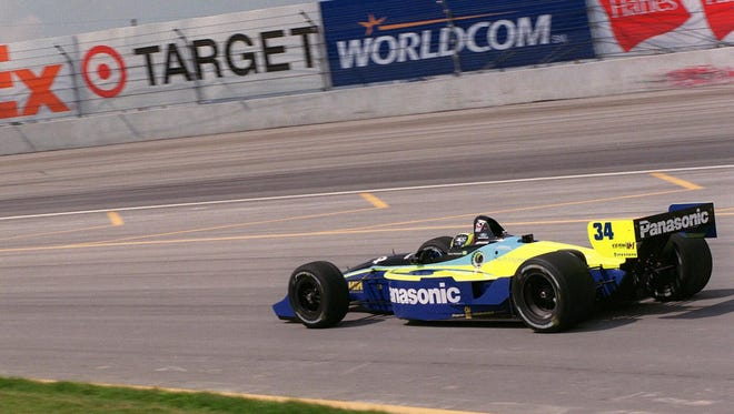 Tarso Marques of Brazil pulls out onto the track during a pratice run at the Chicago Motor Speedway on Friday July 28 2000 in preparation for Sunday's Target Grand Prix in Cicero Ill. (AP Photo/Chicago Sun-Times Brian Jackson)