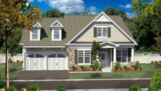 Shingles, stone, and columns create charming curb appeal.