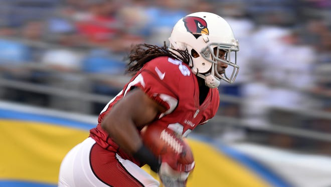 Arizona Cardinals running back Andre Ellington (38) runs the opening kick off out of the end zone during the first quarter against the San Diego Chargers at Qualcomm Stadium.