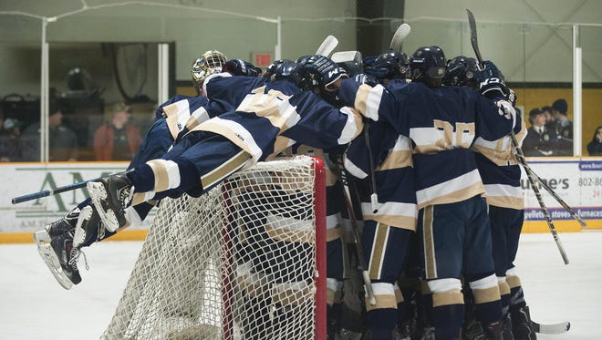 Essex huddles together before the start of the boys hockey game between the Essex Hornets and the BFA St. Albans Bobwhites at the Collins Perley Complex on Wednesday night February 17, 2016 in St. Albans.