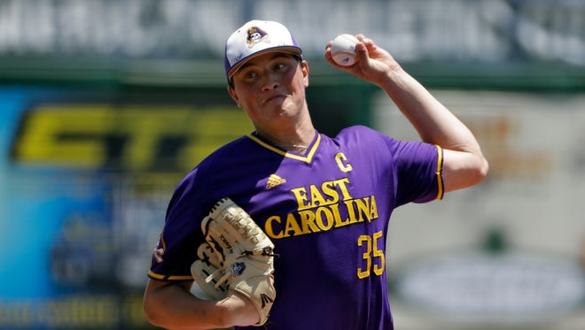 East Carolina pitcher Evan Kruczynski delivers to Houston during the first inning of the American Athletic Conference championship NCAA college baseball game Sunday, May 28.