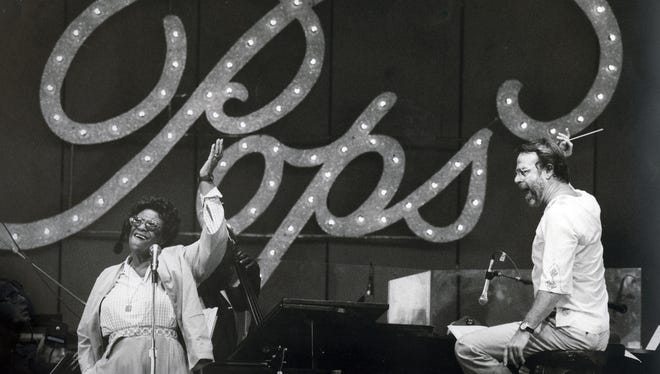 Ella Fitzgerald rehearses with the Cincinnati Pops, conducted by Erich Kunzel, for the premiere concert at Riverbend Music Center on July 4, 1984.