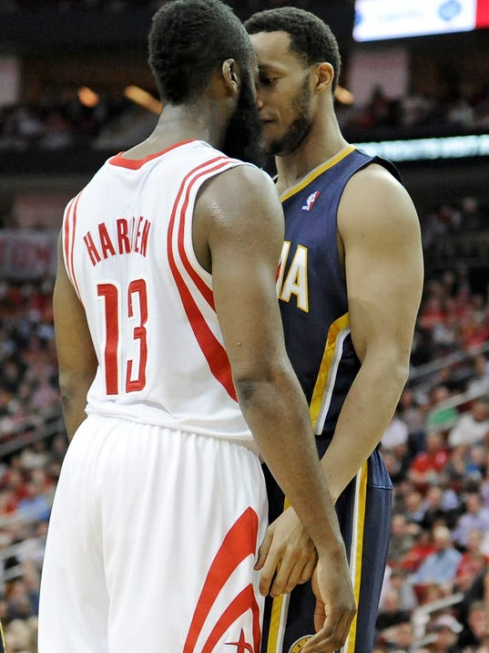 Houston Rockets' James Harden (13) and Indiana Pacers' Evan Turner get in each others' faces in the second half of an NBA basketball game on Friday, March 7, 2014, in Houston. Both players received double technical fouls for the confrontation that included shoving. (AP Photo/Pat Sullivan)