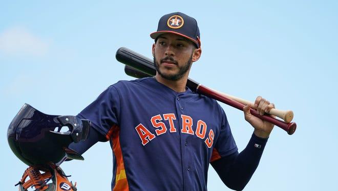 Carlos Correa helped lead the Astros to the World Series title last season.