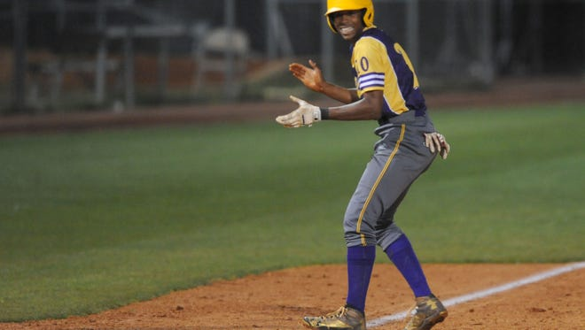 Hattiesburg High School player Joseph Gray makes it safe to third base during a game against Petal High School.