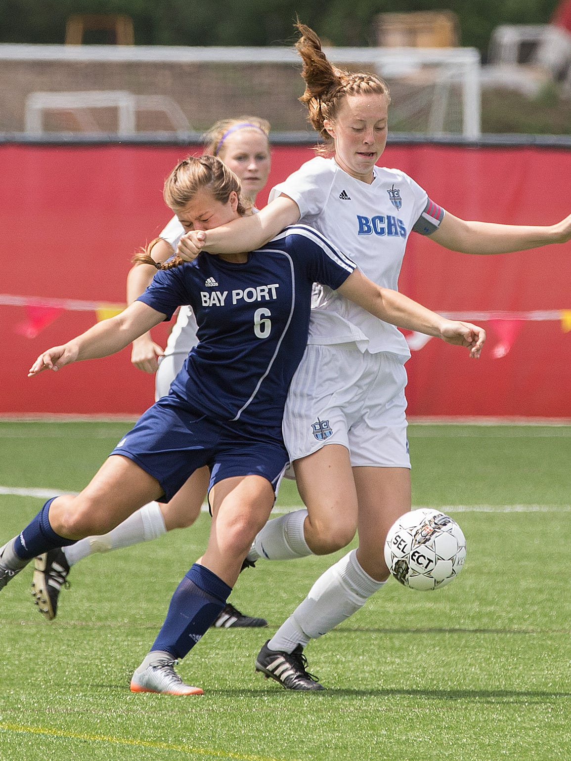 Claire Haynes (right) of Brookfield Central collides