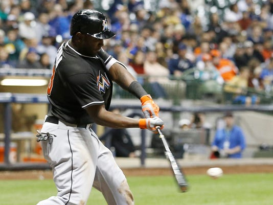Miami Marlins' Marcell Ozuna hits a home run during the sixth inning of a baseball game against the Milwaukee Brewers Saturday, April 30, 2016, in Milwaukee. (AP Photo/Morry Gash)