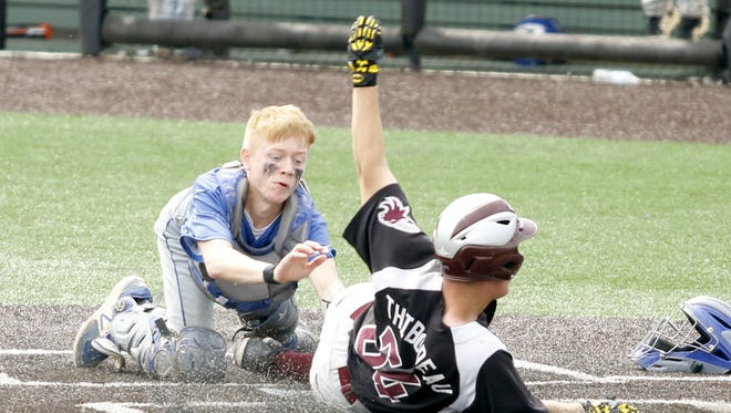 Deposit/Hancock catcher Bob Lewis tags out Fort Plain's Bryce Thibodeau at home plate June 9 during the Class D state championship game at Binghamton University.