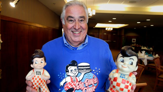 Larry Ladin shows off his commemorative Big Boy restaurant T-shirt and props at Ovation Sarah Chudnow in Mequon, which is planning a Big Boy reunion next week. He is faithfully recreating the Big Boy burger and fixin's and serving to a crowd.