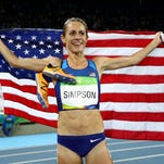 Jennifer Simpson of the United States celebrates with the American flag after winning the bronze medal Tuesday, Aug. 16, in the Women's 1500-meter Final during the Rio 2016 Olympic Games at the Olympic Stadium in Rio de Janeiro.