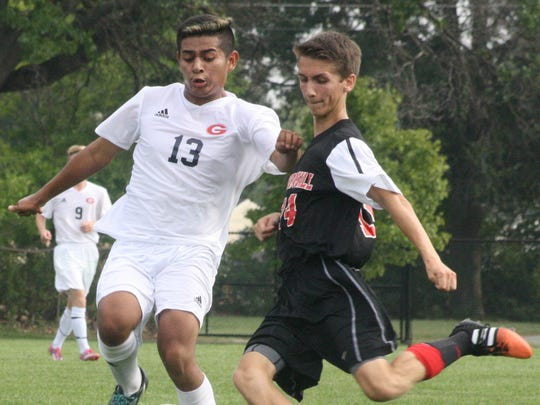 Westland John Glenn's Alfredo Vivar (13) and Churchill's Conner Rash arrive at the ball simultaneously Tuesday afternoon.