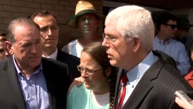 Rowan County (Ky.) clerk Kim Davis, center, stands with Republican presidential candidate Mike Huckabee, left, and Liberty Council attorney Mat Staver after her release from the Carter County Detention Center in Grayson, Ky., on Tuesday, Sept. 8, 2015.