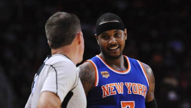 Knicks forward Carmelo Anthony with referee Brent Barnaky during Tuesday's preseason opener in Houston.