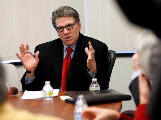 Former Texas governor Rick Perry talks with area business