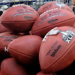 Super Bowl XLIX footballs are stacked for final inspection in Ada, Ohio, on Jan. 20.
