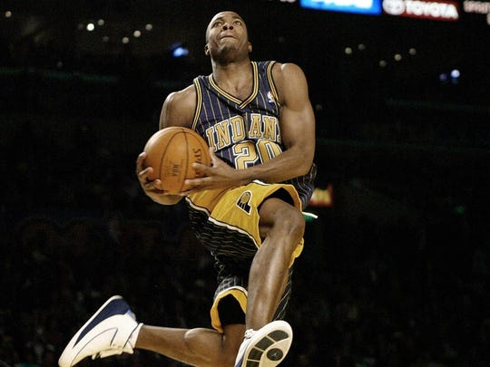 Fred Jones from the Indiana Pacers flies to dunk the ball during competition at the NBA All Stars weekend in Los Angeles 14 February 2004.  Jones won the Slam Dunk unseating two-time defending champion Jason Richardson of the Golden State Warriors.   AFP PHOTO / HECTOR MATA (Photo credit should read HECTOR MATA/AFP/Getty Images)