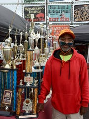 Lamarr Marshall, owner of Smoke Shack BBQ of Columbus, Ohio, with some of the trophies he has won.