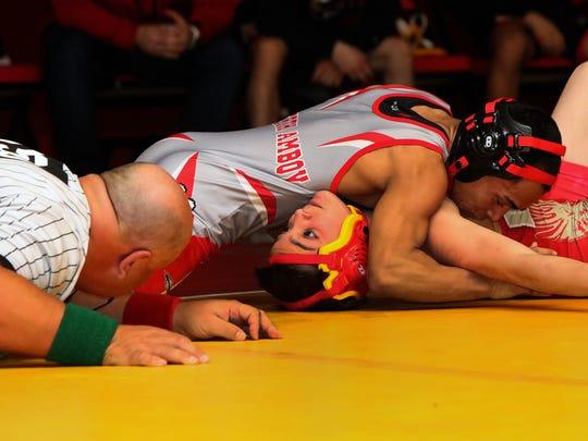 Perth Amboy's Joe Pacheco wrestles Edison's Michael O'Brien