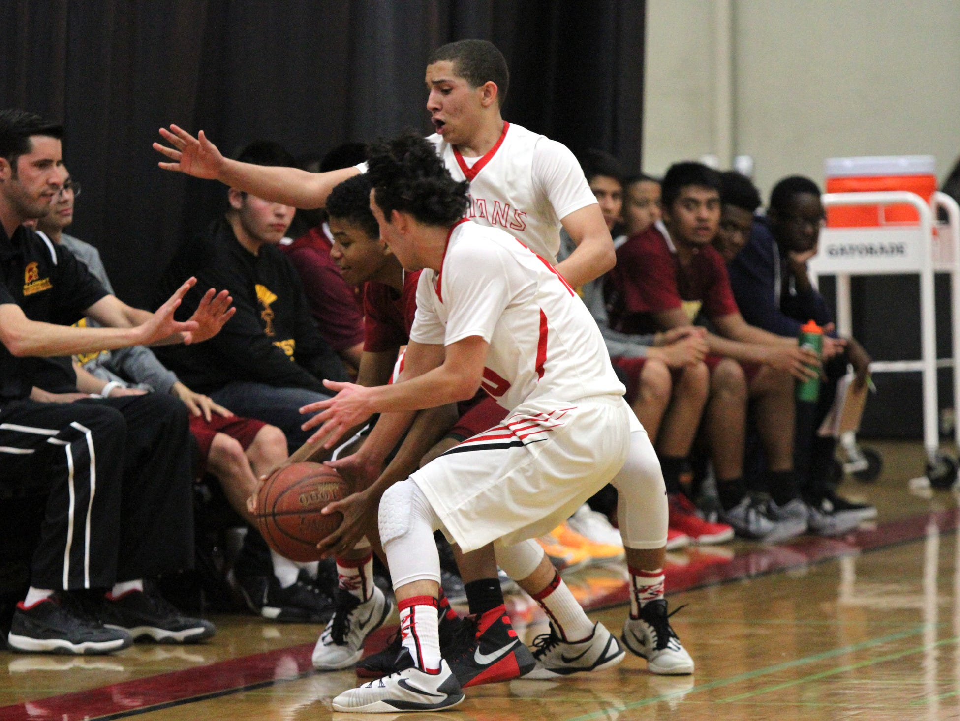 Palm Springs' players put the pressure on Hillcrest during the playoff game in Palm Springs on Wednesday.