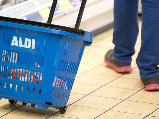 A customer shops in an Aldi supermarket store in London.