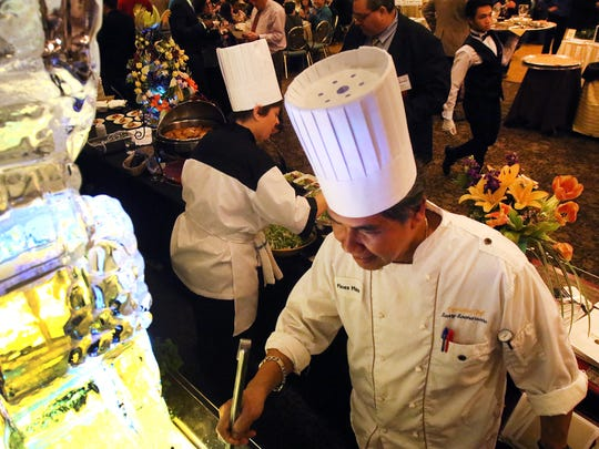 Sonny Soemarsono, executive chef at the Pines Manor, prepares for the Edison Chamber of Commerce's 19th annual Taste of Middlesex held at the Pines Manor in Edisonn on Monday.