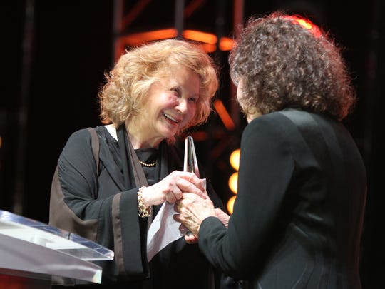 Lily Tomlin presents her partner Jane Wagner with the Joanna Jakway Community Hero Award during the 23rd annual Evening Under The Stars held at the O'Donnell Golf Club in Palm Springs on Saturday, April 30, 2016.