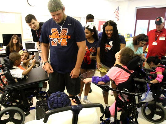 Middlesex County football players and cheerleaders spent Monday at the Lakeview School in Edison meeting the students who they will play for in the MyCentralJersey.com Snapple Bowl XXIII Thursday.