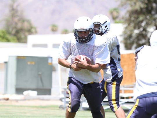 08/17/16 Taya Gray, Special to The Desert SunDesert Chapel's running back Chris Cain runs the ball during practice at the school in Palm Springs on Wednesday, August 17, 2016.