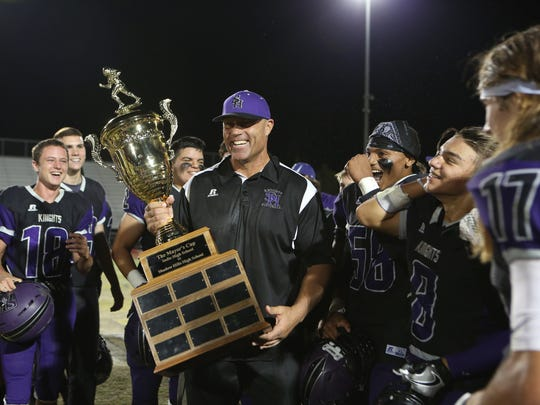 Coach Ron Shipley and his Shadow Hills players celebrate their win in the inaugural Mayor's Cup game against Indio High at Shadow Hills High School in Indio on Thursday night, October 6, 2016.