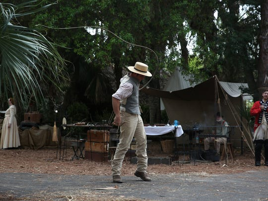 Colton Zeitler, of Naples, demonstrates how Florida crackers would crack their whips during the Old Florida Festival at Collier County Museum in Naples on March 8, 2015
