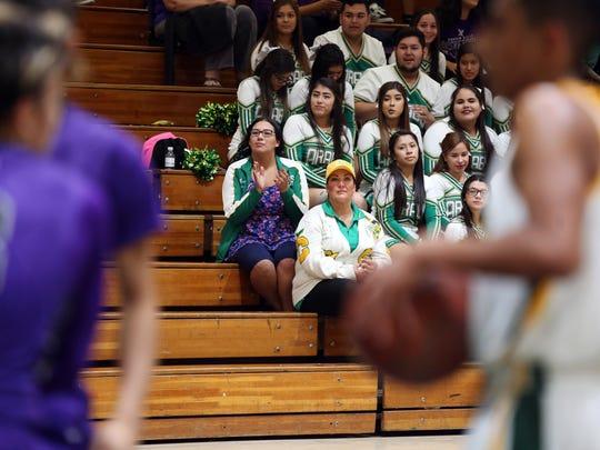 Coachella Valley High School head cheer coach Raquel Hernandez, center left, and assistant cheer coach Raquel Canela are both cancer survivors.