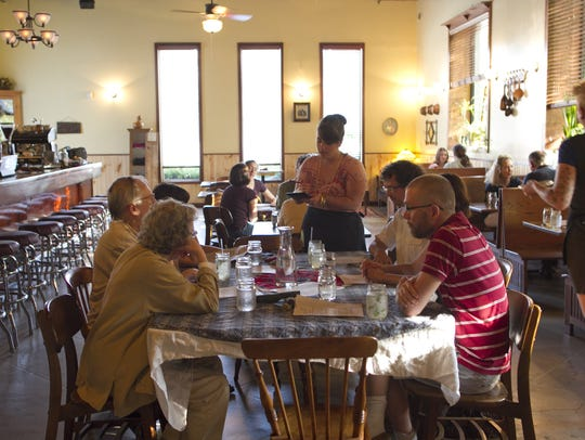 Sara Fritz takes orders at Trumpet Blossom Cafe on