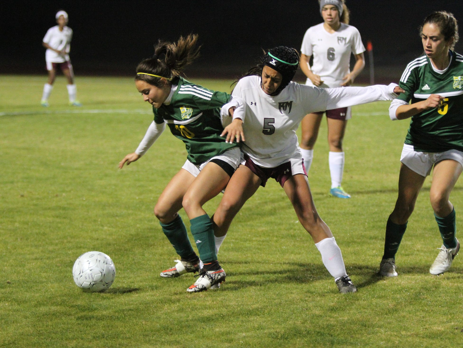 Coachella Valley's Brianda Rios, left, and Rancho Mirage's Caitlin Estrin battle for the ball during the game in Rancho Mirage on Thursday, January 19, 2017. Rancho Mirage won.